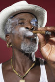 African Man Smoking Cigar — Stock Photo