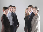 Two groups of businesspeople in two rows — Stock Photo