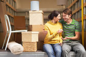Couple Sitting in Back of Moving Van — Stock Photo