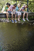 Teenagers Sitting on Bridge — Stock Photo
