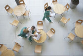 Physicians talking in cafeteria — Stock Photo