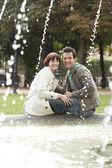 Couple Relaxing Near Fountain — Stock Photo