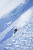 Skier on steep slope — Stock Photo