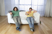 Two men watching television — Stock Photo