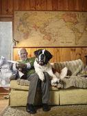 Senior man with St Bernard dog — Stock Photo