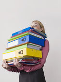 Office worker with heavy binders — Stock Photo