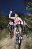Boys and girl riding bicycles — Foto Stock