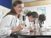 High school students using microscopes — Stock Photo