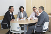 Businesspeople having meeting in office — Stock Photo