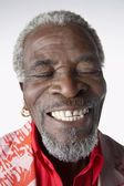 African Man Smiling, eyes closed — Stock Photo
