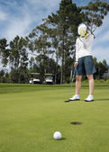 Disappointed golfer on putting green — Stock Photo