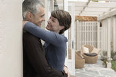 Smiling couple embracing on patio — Stock Photo