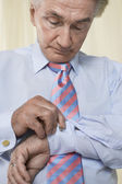 Man Buttoning Cuff Links — Stock Photo