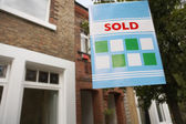 Sold sign in front of house — Stock Photo