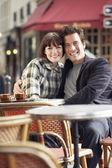 Couple sitting outside cafe — Stock Photo