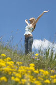 Woman standing in field — Stock Photo