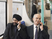 Businessmen Using Cell Phones — Stock Photo