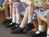 Escolares sentado — Foto de Stock