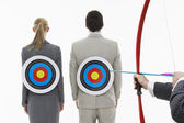 Two business people with targets on backs — Stock Photo