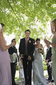 Bride and Groom Exiting Ceremony — Stock Photo