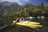 People paddling kayaks — Stock Photo
