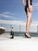 Woman in bathing suit  with champagne — Stock Photo