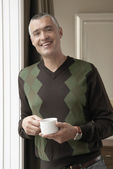 Smiling man with cup of coffee — Stock Photo