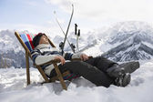 Skier resting on deckchair — Stock Photo