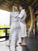 Couple in bathrobes embracing — Stock Photo