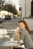 Woman sitting in Cafe — Stock Photo