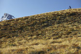 Cyclist riding on hill — Stock fotografie