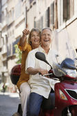 Couple sightseeing on scooter — Stock Photo