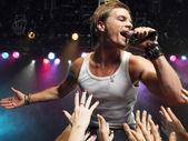Man Singing on stage — Stock Photo
