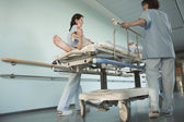 Nurses Moving Patient on gurney — Stock Photo