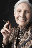 Senior Woman Smoking Cigarillo — Stock Photo