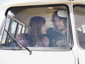 Couple in camper van smiling at each other — Stock Photo