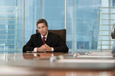 Businessman sitting at conference table — Stock Photo