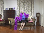 Senior woman wearing feather boa — Stock Photo