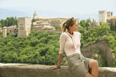 Tourist Relaxing on City Wall — Stock Photo