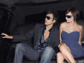 Couple in backseat of limousine — Stock Photo