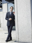 Businessman standing  outside — Stock Photo