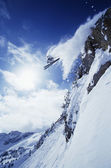 Skier jumping from mountain ledge — Stock Photo