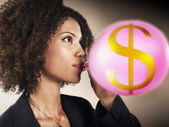 Businesswoman Blowing Money Bubble — Stock Photo