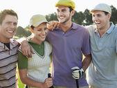 Golfers with arms around — Stock Photo