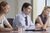 Businesspeople sitting at business meeting — Stock Photo