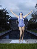 Senior woman posing by pool — Stock Photo