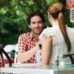 Couple sitting at sidewalk cafe — Stock Photo