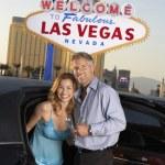 Couple against Las Vegas sign — Stock Photo