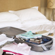 Stock Photo: Packed Suitcase on Bed