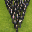 Business people standing in triangle formation — Stock Photo #33840929